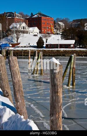 The ice bound harbor of Rockport Harbor, Maine, winter - Stock Photo