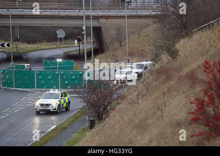 A silver Audi is almost totally hidden by screens at the scene near junction J24 of the M62 in Huddersfield where - Stock Photo