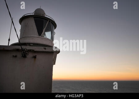 The lighthouse at sunset on the Sheeps Head Peninsula County Cork Ireland - Stock Photo