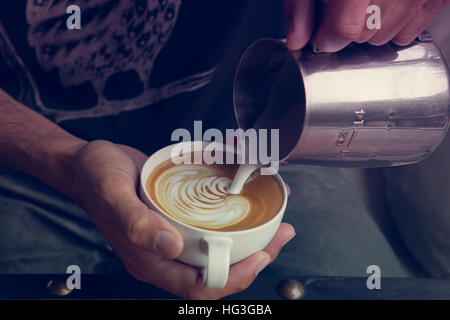 Making coffee latte art  ' Rosetta ' , Vintage tone color - Stock Photo