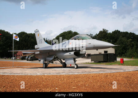 F-16 fighter jet on display at the entrance of Florennes Airbase. Belgium - Stock Photo
