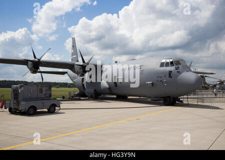 US Air Force Lockheed C-130J Hercules cargo plane on display at the ILA airshow at Berlin Schoneveld airport. - Stock Photo