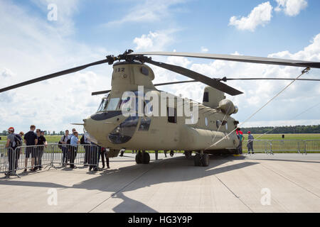 New US Army Boeing CH-47F Chinook helicopter on display at the ILA airshow at Berlin Schoneveld airport. - Stock Photo
