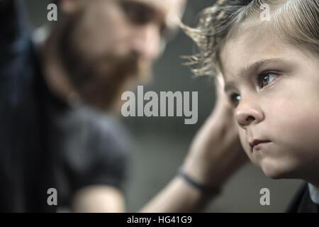 Little boy in barbershop - Stock Photo