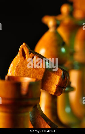Close up of chess pieces .selective focus on a knight piece - Stock Photo