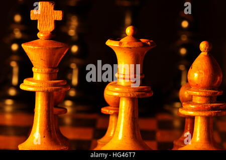 Close-up of wodden chess pieces on the chessbord - Stock Photo
