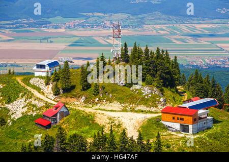 Mountain ski resort in Postavarul Massif, Poiana Brasov, Romania - Stock Photo