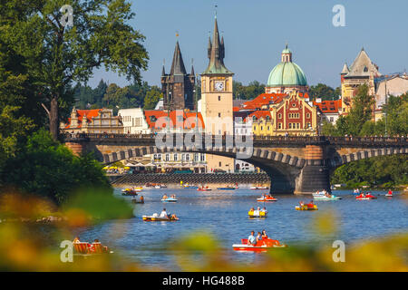 Prague, Czech Republic, September 20, 2011: People sail in small boats on the Vltava River, Prague - Stock Photo