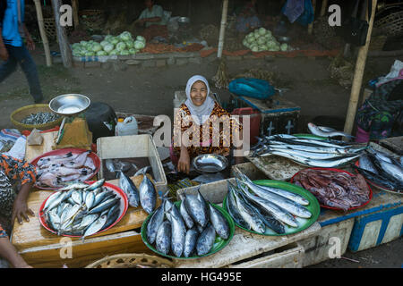 Vendor selling fresh seafood at a street market in wan for Oriental fish market