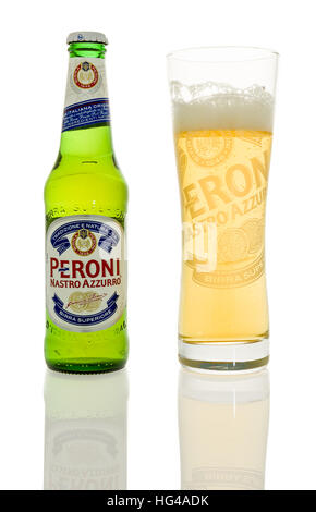 Winneconne, WI - 1 January 2017:  Bottle of Peroni beer with glass on an isolated background. - Stock Photo