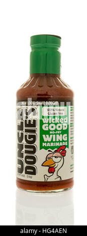 Winneconne, WI - 2 January 2017:  Bottle of Uncle Dougie's wing sauce on an isolated background. - Stock Photo