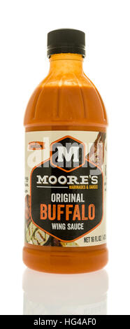 Winneconne, WI - 2 January 2017:  Bottle of Moore's wing sauce on an isolated background. - Stock Photo