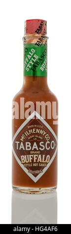 Winneconne, WI - 2 January 2017:  Bottle of Tobasco brand wing sauce on an isolated background. - Stock Photo