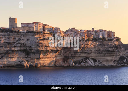 Old citadel at dawn, in early morning light, seen from the sea, Bonifacio, Corsica, France, Mediterranean - Stock Photo