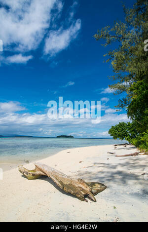 Turquoise water and a white beach on Christmas Island, Buka, Bougainville, Papua New Guinea, Pacific - Stock Photo