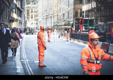 London UK, Workers blocking the road traffic for intervention - Stock Photo