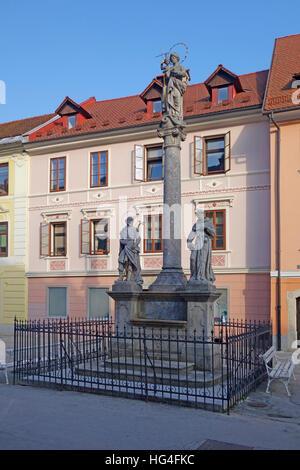 Marian and Holy Trinity column (plague column), Mestni Trg, Skofja Loka, Slovenia, Europe - Stock Photo