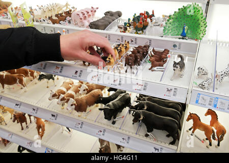 Schleich animals toys, plastic figurines in a display stand in a german toyshop - Stock Photo