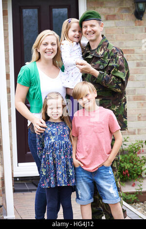 Portrait Of Family With Army Father Home On Leave - Stock Photo