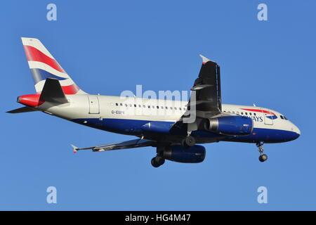 British Airways Airbus A319 G-EUPK landing at London Heathrow Airport, UK - Stock Photo