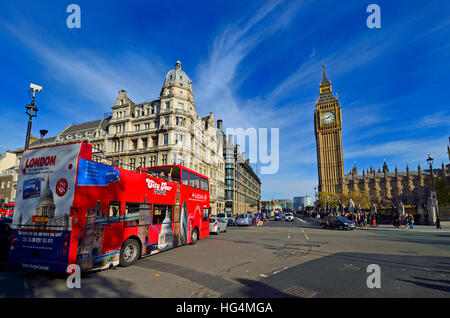 London, England, UK. Double-decker tourist sightseeing bus in Parliament Square - Stock Photo