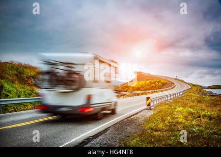 Caravan car travels on the highway. Caravan Car in motion blur. Norway. Atlantic Ocean Road or the Atlantic Road (Atlanterhavsveien) been awarded the