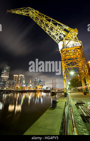 Old crane in Puerto Madero at night, San Telmo, Buenos Aires, Argentina, South America - Stock Photo