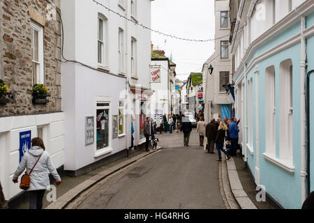 Fore Street in Fowey, Cornwall. A popular tourist spot along the Cornish Coast and often busy with people all year - Stock Photo