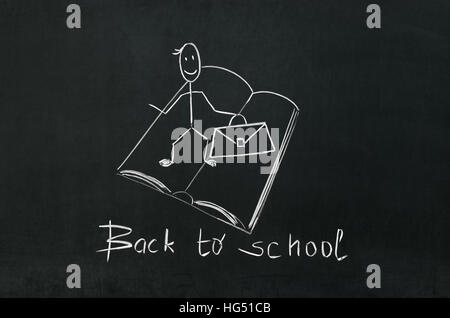 On the blackboard the words back to school - Stock Photo