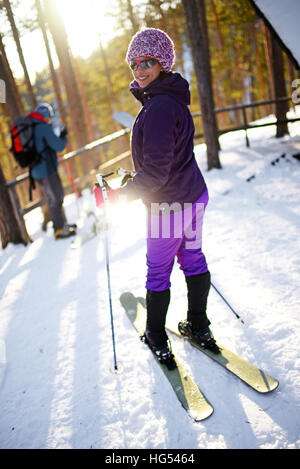 Young woman practicing Altai Skiing in Pyhä ski resort, Lapland, Finland - Stock Photo