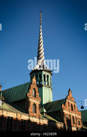 Denmark, Copenhagen, Slotholmsgade, twisted dragon spire of Borsen, the former stock exchange - Stock Photo