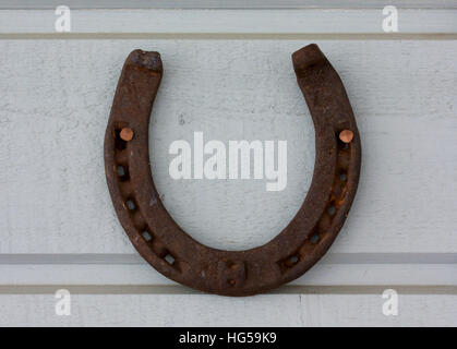 Horse Shoe Hanging On An Old Shed Door Stock Photo