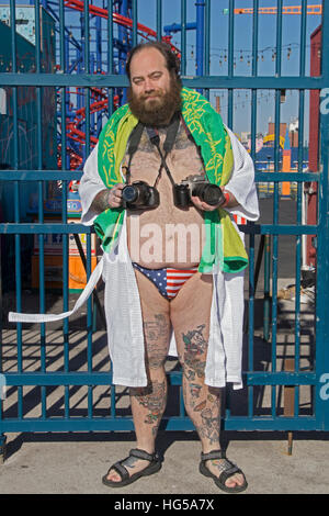 An eccentric New York photographer with two cameras in Coney Island for the annual Polar Bear Club swim. In Brooklyn, - Stock Photo