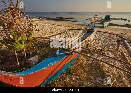 Fishing boats pulled up onto Paliton beach, Siquijor, Philippines, Southeast Asia, Asia - Stock Photo