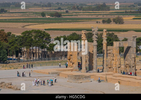 Overview of All Nations Gate and tourist groups setting off on their tours, Persepolis, UNESCO, Iran, Middle East - Stock Photo