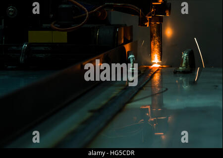 Welding robots movement in a car factory welding robot welding splashes brews argon - Stock Photo