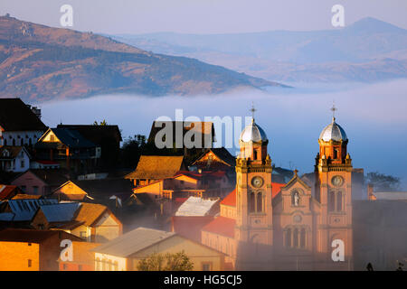 Early morning mist on the Haute Ville old town, Ambozontany Cathedral, Fianarantsoa, central area - Stock Photo