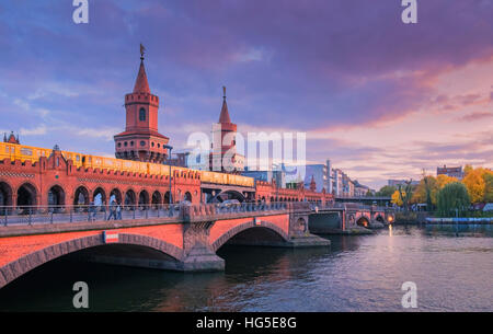 U-Bahn train crossing Oberbaum Bridge over the River Spree, Berlin, Germany - Stock Photo