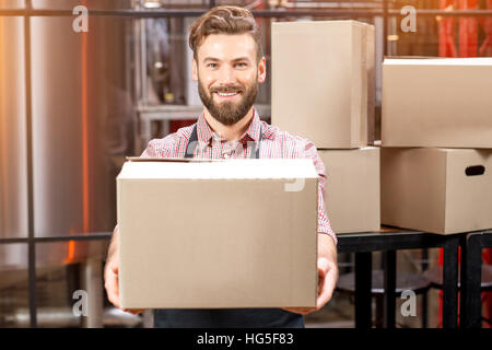 Professional courier with boxes - Stock Photo