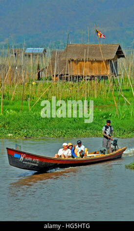 tourists in boat,floating garden, Inle lake, Myanmar - Stock Photo