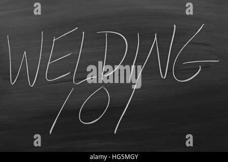 The words 'Welding 101' on a blackboard in chalk - Stock Photo