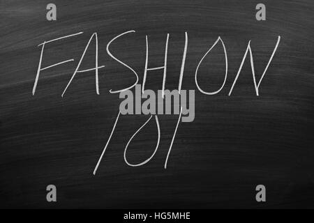 The words 'Fashion 101' on a blackboard in chalk - Stock Photo