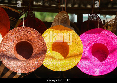 Three hats for sale in an african market - Stock Photo