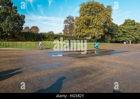 London, United Kingdom - October 17, 2016: People are visiting Kensington Gardens outside of Kensington Palace in - Stock Photo