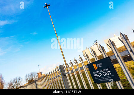 British steel Scunthorpe, Scunthorpe steelworks keep out sign on fence in town in North Lincolnshire, England UK - Stock Photo