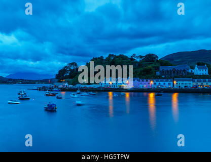UK, Scotland, Highlands, Isle of Skye, Twilight view of Portree. - Stock Photo
