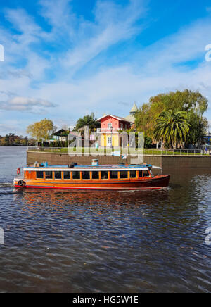 Argentina, Buenos Aires Province, Tigre, Vintage mahogany motorboat on the Tigre River Canal. - Stock Photo