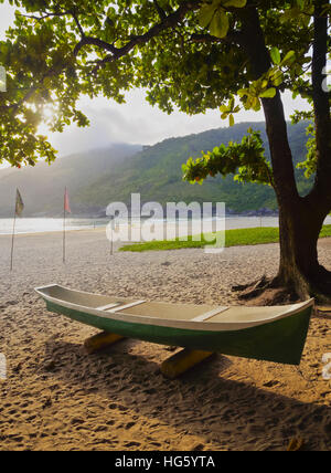 Brazil, State of Sao Paulo, Ilhabela Island, Traditional Colourful Boats on the beach in Bonete. - Stock Photo