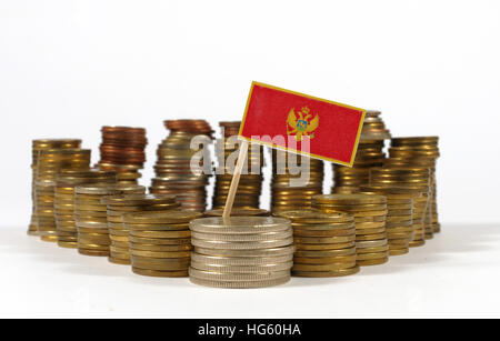 Montenegro flag waving with stack of money coins - Stock Photo