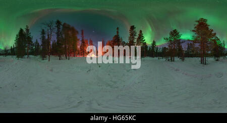 An aurora over the winter forest with glowing tent in the Kola Peninsula, Russia. - Stock Photo